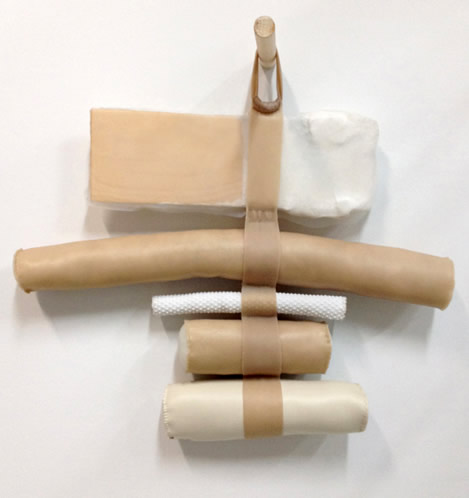 Wood, fabric, plaster, vinyl, polyester fiberfill, silicone rubber